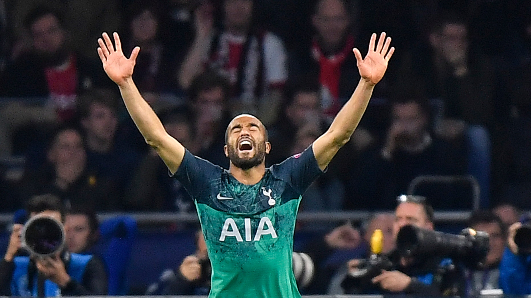Tottenham's Lucas Moura celebrates after scoring his side's second goal during the Champions League semifinal second leg soccer match between Ajax and Tottenham Hotspur at the Johan Cruyff ArenA in Amsterdam, Netherlands, Wednesday, May 8, 2019. (AP Photo/Martin Meissner)