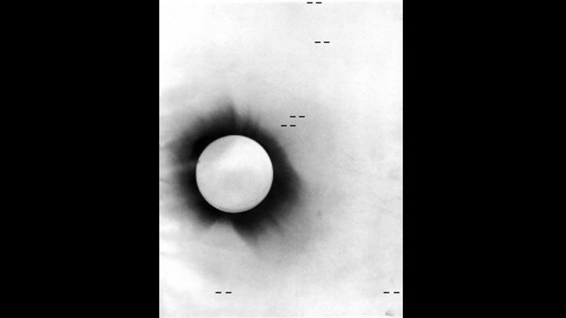 Negative photo of the 1919 solar eclipse taken from Príncipe Island. The position of the stars that were examined in the historic test of Einstein's theory of gravity are marked in this photo.