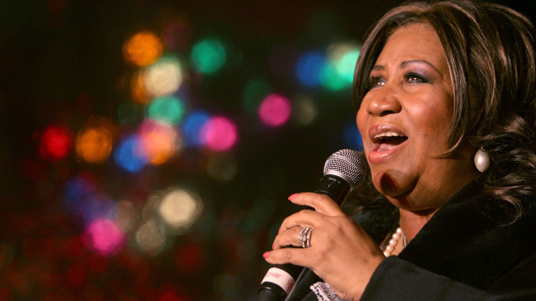 FILE - In this Dec. 4, 2008 file photo, Aretha Franklin performs during the 85th annual Christmas tree lighting at the New York Stock Exchange in New York.