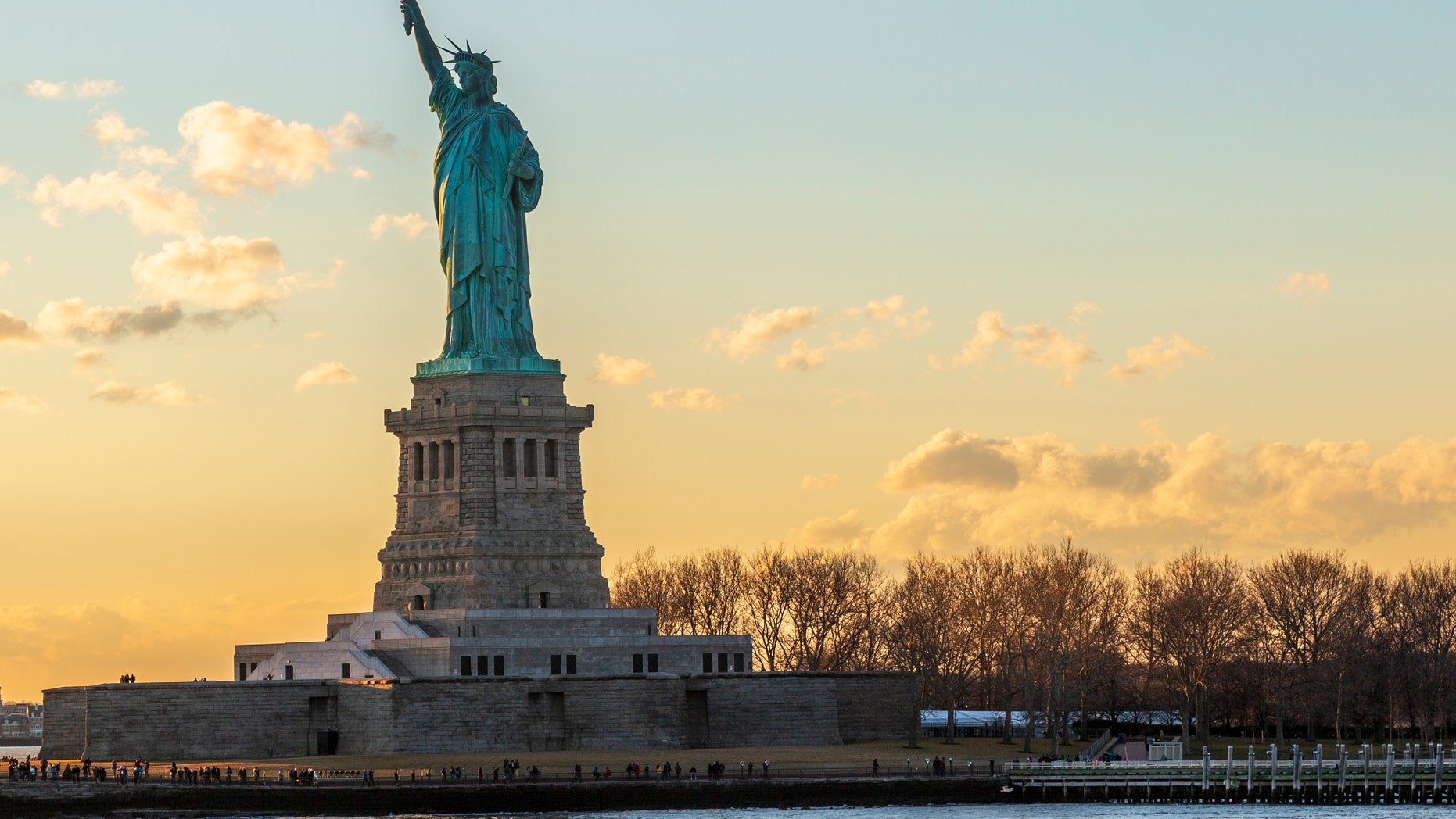 Statue of liberty horizontal during sunset in New York City, NY, USA