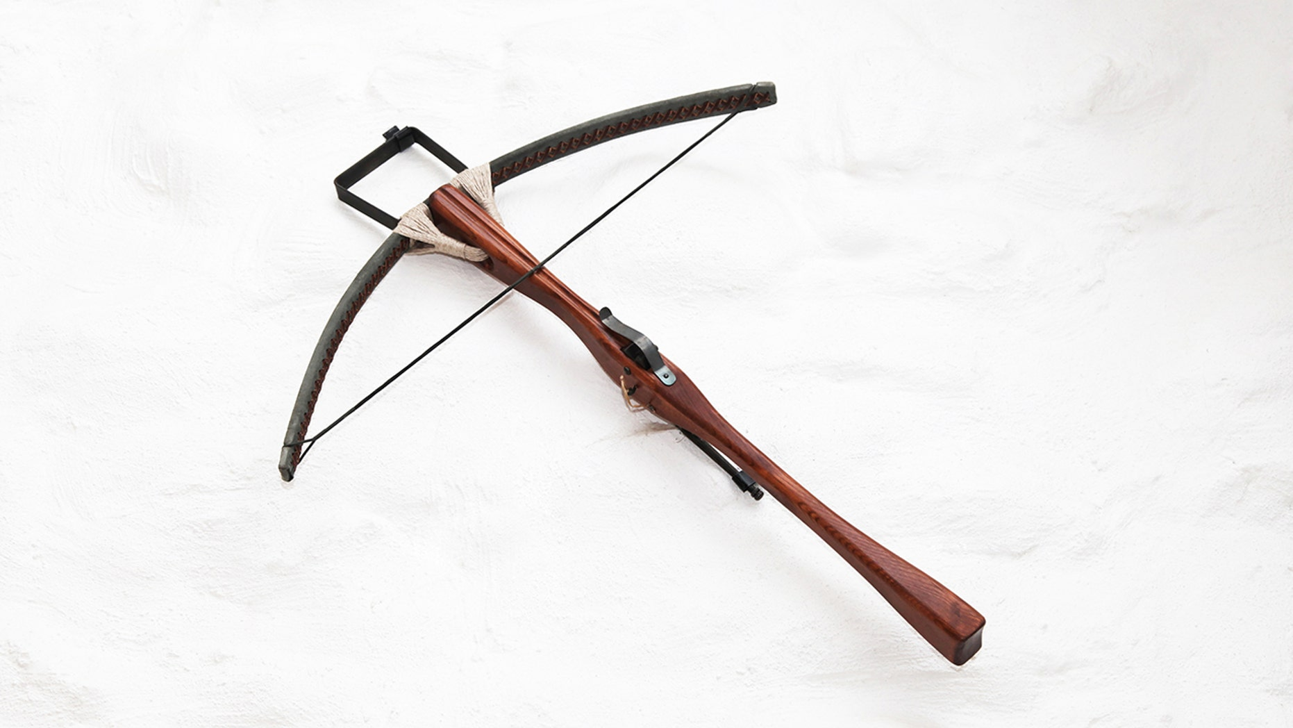 An antique crossbow. Police are investigating the deaths of three hotel guests after they were found dead with crossbow bolts in them and two crossbows nearby.