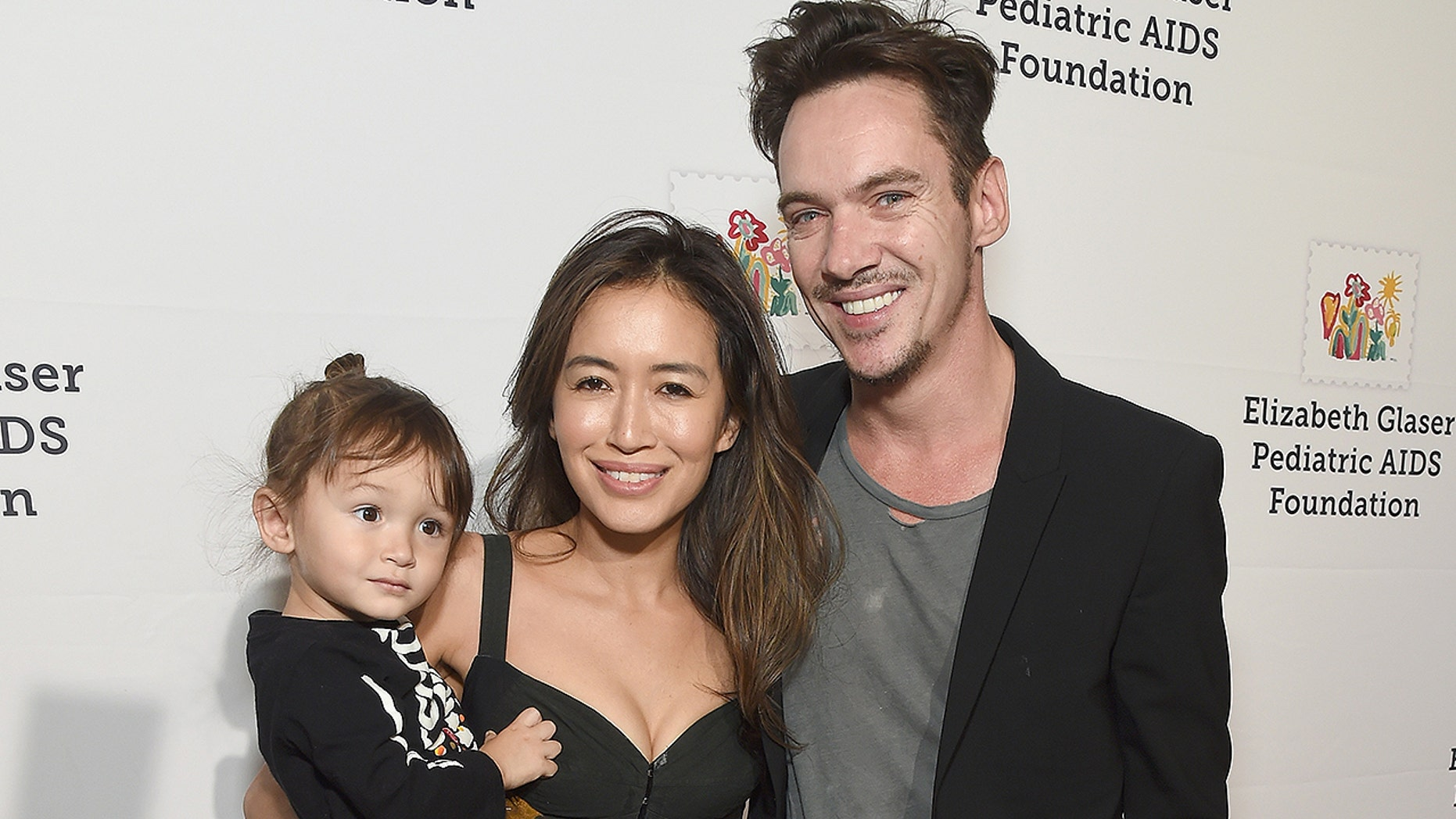 Mara Lane and Jonathan Rhys Meyers pose with son Wolf in October 2018. The family was reportedly on a plane with Alki David when the Coca-Cola heir was arrested.