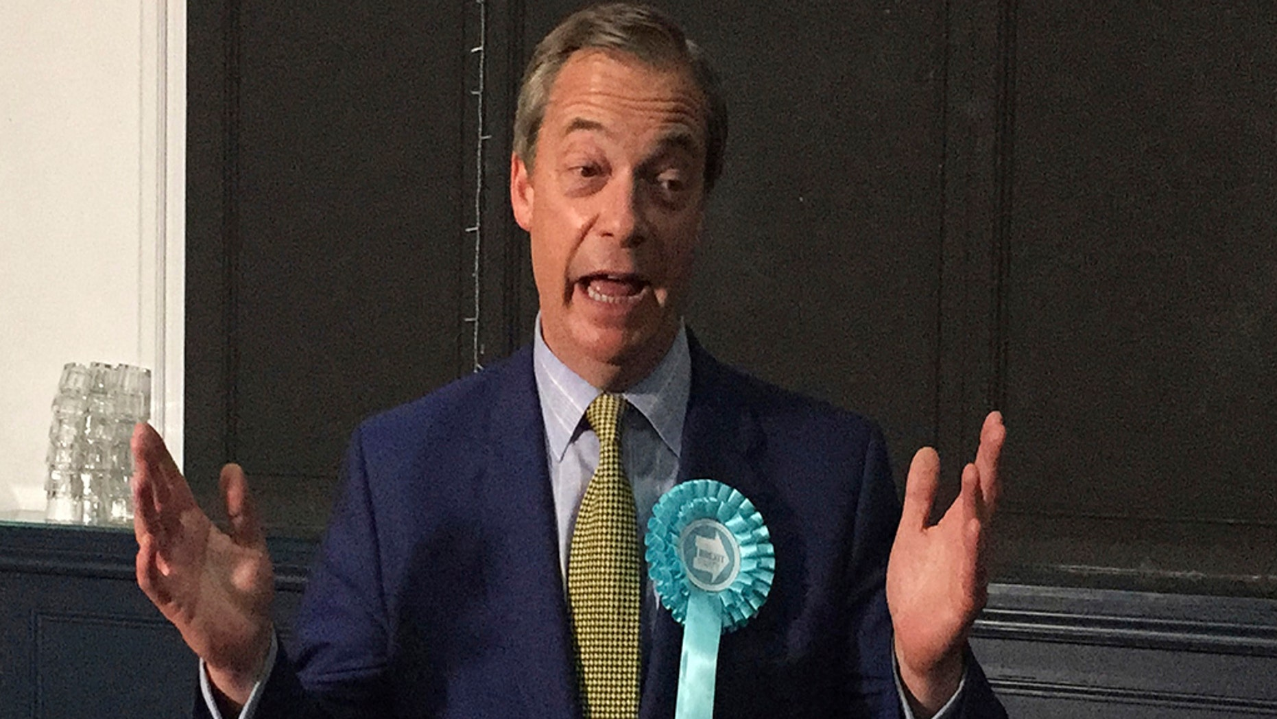 Brexit Party Leader Nigel Farage moves, during his party on the Corn Exchange, in Edinburgh on Friday 17. May 2019. (Tom Eden / PA via AP)