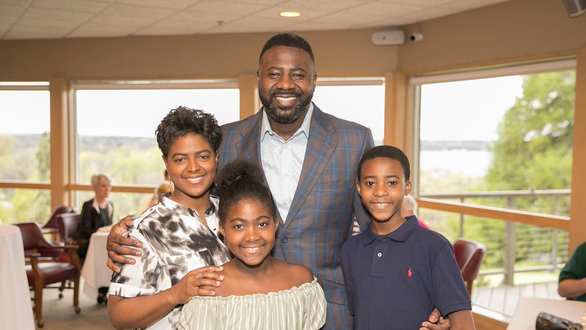 The wife and daughter of men's basketball assistant coach Howard Moore were killed in a Michigan automobile accident, The University of Wisconsin said.