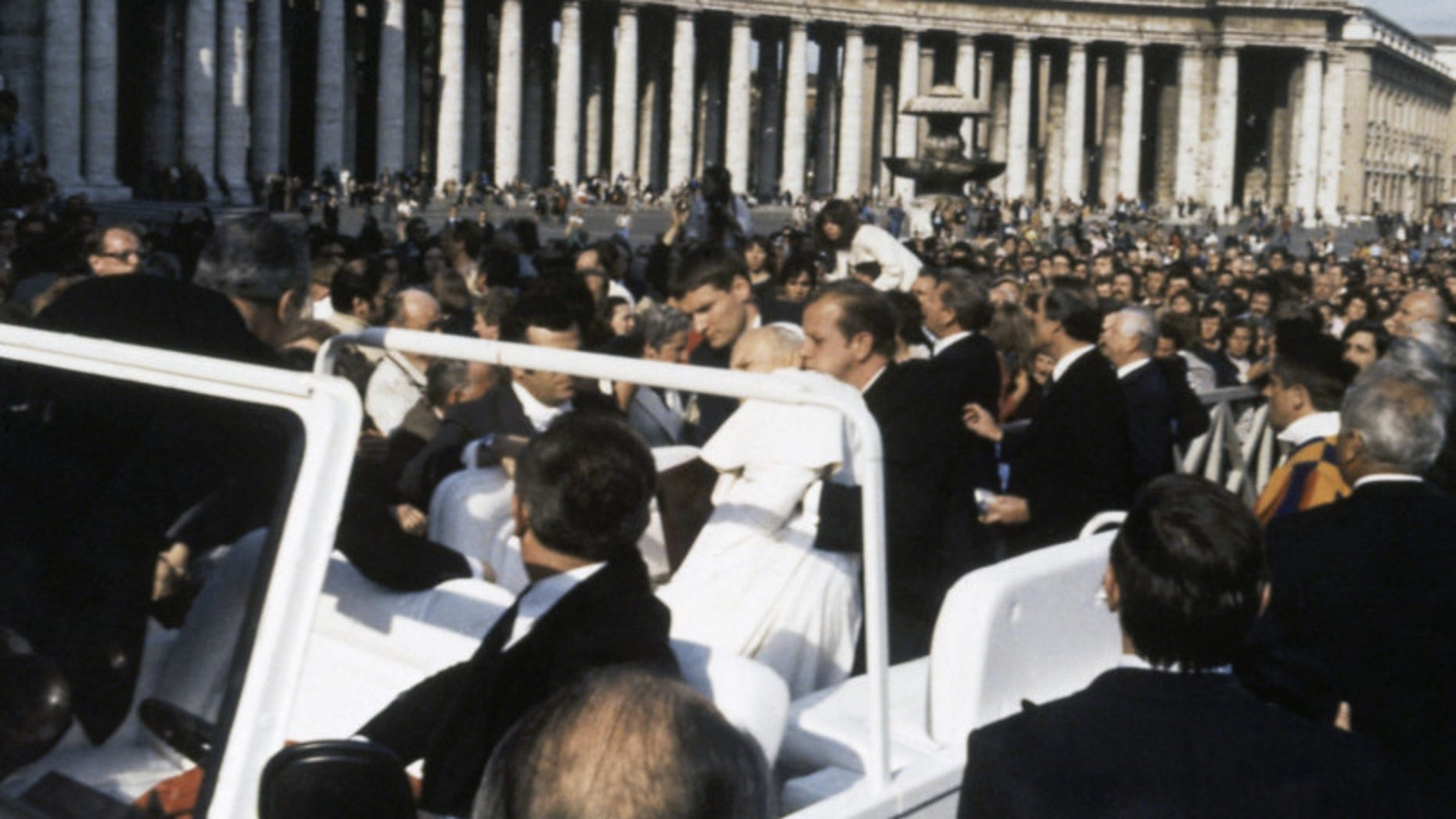 Pope John Paul II is held up by his secretary, Stanislaw Dziwisz after being shot at by Turkish student Ali Acga and seriously wounded in Vatican City on May 13, 1981. The Assassination attempt took place during the regular general audience in St. Peter's Square on Wednesday. (AP Photo/Arturo Mari)