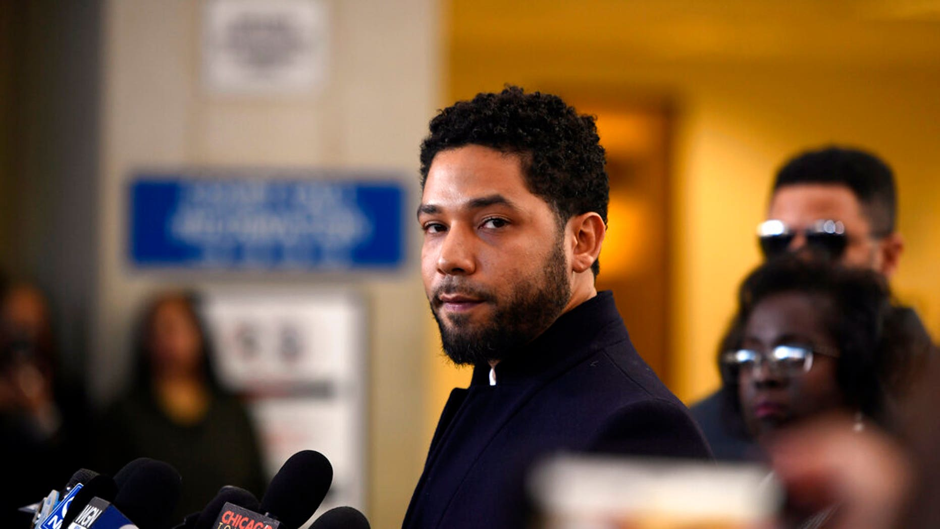 """FILE - In this March 26, 2019 file photo, Actor Jussie Smollett talks to the media before leaving Cook County Court after his charges were dropped, in Chicago. Chicago's top prosecutor has released 2,000 documents in the Jussie Smollett's case and explained she recused herself from an investigation into his claim he'd been the target of a racist, anti-gay attack solely because of false rumors she was related to the """"Empire"""" actor. The Friday, May 31, 2019 statement from Cook County State's Attorney Kim Foxx came two months after her office's suddenly dropped all charges against Smollett that accused him of staging the attack on himself. (AP Photo/Paul Beaty, File)"""