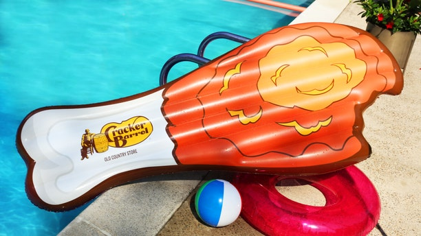 The chain designed the fried-chicken pool float for its anniversary, which officially takes place in September.