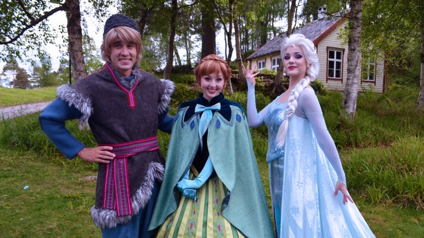 """Kristoff, Anna, and Elsa from Disney's """"Frozen"""" at the Sunnmøre Museum in Ålesund, Norway."""