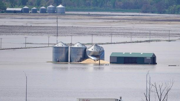Grain bins stand in floodwaters from the Missouri River, in Hamburg, Iowa, on May 10. (AP Photo/Nati Harnik, File)