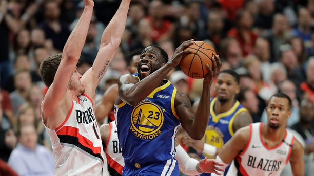 Golden State Warriors forward Draymond Green (23) shoots against Portland Trail Blazers forward Meyers Leonard, left, during the first half of Game 3 of the NBA basketball playoffs Western Conference finals, on Saturday in Portland, Ore. (Associated Press)