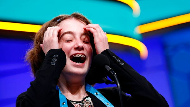 Colette Giezentanner, 12, of St. Louis, laughs as she competes in the finals of the Scripps National Spelling Bee, Thursday, May 30, 2019, in Oxon Hill, Md. (Associated Press)