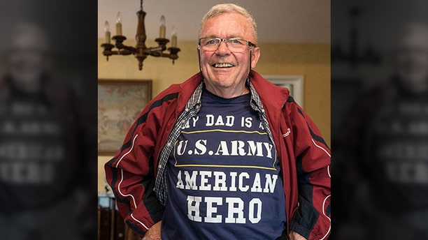 In this photo taken May 8, 2019, Andre Gantois shows his T-shirt in Ludres, eastern France. The retired French postal worker figured he'd likely go to his grave without ever knowing who his father was, unable to identify the U.S. serviceman who had fought his way across France after the D-Day landings, taken a bullet to the skull and been nursed back to health in a military hospital by Gantois' mother.