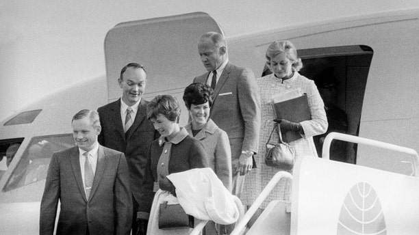 "File photo - The Apollo 11 astronauts and their wives leaving the Presidential aircraft at Heathrow Airport in London during their ""Giant Leap"" global goodwill tour. Neil Armstrong is accompanied by his wife Janet, who can be seen the lunar brooch on her lapel."
