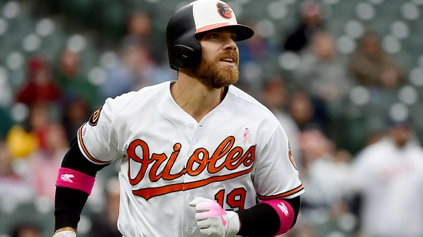 Chris Davis of the Baltimore Orioles rounds the bases after hitting a home run at Camden Yards on May 12, 2019 in Baltimore, Maryland. He met with Henry Frasca on Saturday, a 9-year-old boy who helped break his record hitless streak. (Photo by Will Newton/Getty Images)