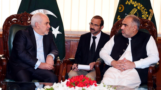 In this photo released by the National Assembly, Iranian Foreign Minister Mohammad Javad Zarif, left, meets Speaker National Assembly Asad Qaiser in Islamabad, Pakistan, Friday, May 24, 2019. Zarif is in Pakistan Friday on a critically timed visit amid a crisis between Tehran and Washington and ahead of next week's emergency Arab League meeting called by Saudi Arabia as regional tensions escalate. (Pakistan National Assembly via AP)