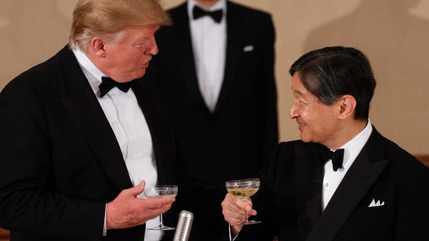 U.S. President Donald Trump toasts with Japan's Emperor Naruhito during a State Banquet at the Imperial Palace, Monday, May 27, 2019, in Tokyo. (AP Photo/Evan Vucci)