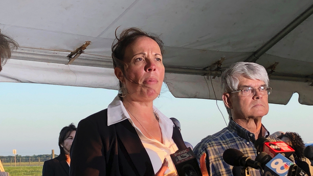 Lisa Noland, who survived an attack at the hands of serial killer Bobby Joe Long, speaking to reporters after his execution. (AP Photo/Brendan Farrington)