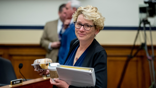 FIEL - In this April 2, 2019, file photo, Rep. Chrissy Houlahan, D-Pa., arrives for a House Armed Services Committee budget hearing for the Departments of the Army and Air Force on Capitol Hill in Washington. Congresswomen with military service in their past, some of them forged on post-Sept. 11 wars, are hoping to create their own caucus to drive an agenda to support the nation's growing ranks of female service members. (AP Photo/Andrew Harnik, File)