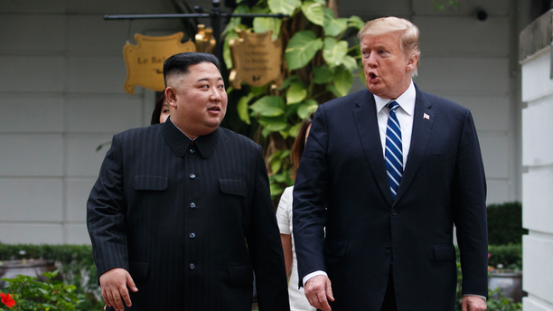 FILE - In this Feb. 28, 2019 file photo, President Donald Trump and North Korean leader Kim Jong Un take a walk after their first meeting at the Sofitel Legend Metropole Hanoi hotel, in Hanoi. North Korea says nuclear negotiations with the United States will never resume unless Washington changes its negotiating tactics. (AP Photo/Evan Vucci, File)