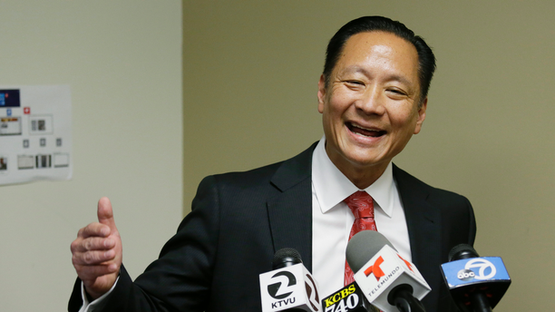 FILE - In this April 26, 2016, file photo, San Francisco Public Defender Jeff Adachi gestures during a news conference in San Francisco. Bryan Carmody, a San Francisco reporter, is seeking the return of property after police raided his home with a sledgehammer, as officials sought to determine the source of a leaked police report into Adachi's death. An attorney for Carmody will make the request Tuesday, May 21, 2019, in San Francisco County Superior Court. (AP Photo/Eric Risberg, File)