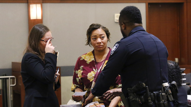 Cadesha Bishop, 25, center, listens to a court officer as her her attorney Baylie Hellman looks on after Bishop's preliminary hearing at the Regional Justice Center on Thursday, May 23, 2019, in Las Vegas. Bishop was arrested May 6 on a murder charge in the death of Serge Fournier, who was pronounced dead on April 23 from complications of blunt force injuries he suffered a month earlier. Bishop is accused of shoving the 74-year-old man off a public bus after witnesses say he asked her to be nice to other passengers. (Bizuayehu Tesfaye/Las Vegas Review-Journal via AP)