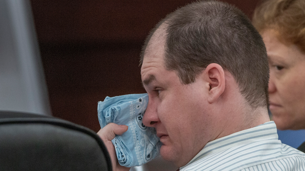 Timothy Jones Jr., charged with killing his five children, wipes his eyes during his trial in Lexington, S.C., Wednesday, May 22, 2019. Lawyers defending Jones turned Wednesday to brain science in an effort to spare their client from the death penalty. (Tracy Glantz/The State via AP, Pool)
