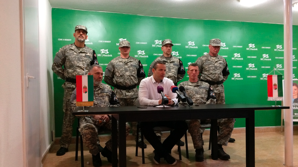 """Laszlo Toroczkai, first row center, head of Hungary's far-right Our Homeland Movement, announces the formation of the National Legion, a """"self-defense group"""" created in the spirit of the Hungarian Guard, which was disbanded by the courts in 2009 in Budapest, Hungary, Tuesday, May 14, 2019. The group's main activities will include """"guarding of traditions"""" and teaching basic military skills. (AP Photo/Pablo Gorondi)"""