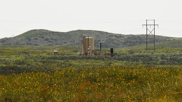 According to court documents released, Shanann Watts' body was found in a shallow grave near this oil tank Aug. 21, 2018, near Roggen, Colorado. Both of her daughter's bodies, 4-year-old Bella and 3-year-old Celeste, were submerged for days in the same oil tanks in rural eastern Colorado, prosecutors said. (Photo by RJ Sangosti/The Denver Post via Getty Images)