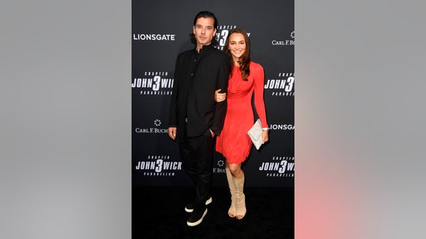 """Gavin Rossdale and Natalie Golba keep close on the red carpet for a special screening of Lionsgate's """"John Wick: Chapter 3 - Parabellum"""" on May 15, 2019 in Hollywood, Calif."""