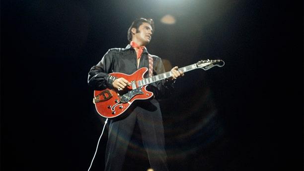 Elvis Presley during a performance at NBC Studios in Burbank, CA .