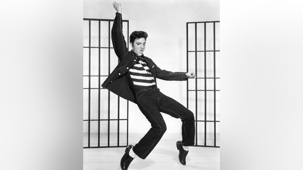 """American singer and actor Elvis Presley on the set of 1957's """"Jailhouse Rock,"""" directed by Richard Thorpe. (Photo by Metro-Goldwyn-Mayer/Sunset Boulevard/Corbis via Getty Images)"""