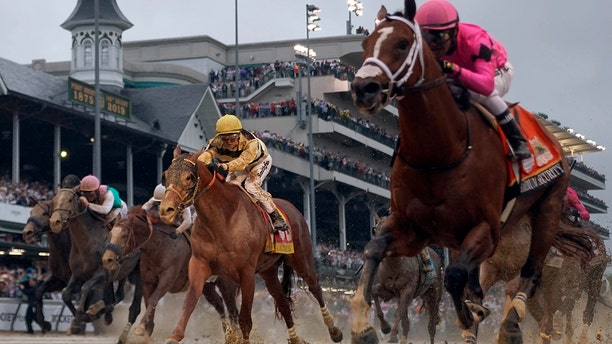 Luis Saez rides Maximum Security, right, across the finish line first against Flavien Prat on Country House during the 145th running of the Kentucky Derby horse race at Churchill Downs (AP Photo/Matt Slocum)