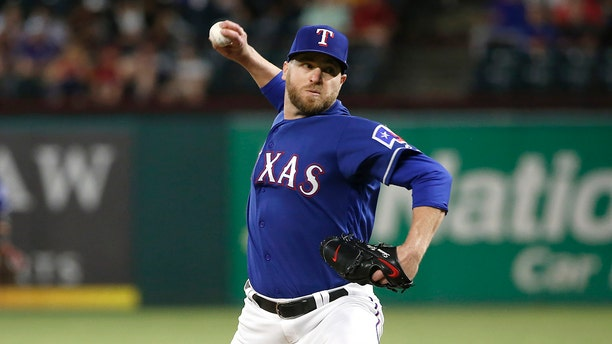 Shawn Kelley #27 of the Texas Rangers throws against the Toronto Blue Jays during the ninth inning at Globe Life Park in Arlington on May 4, 2019 in Arlington, Texas. (Photo by Ron Jenkins/Getty Images)