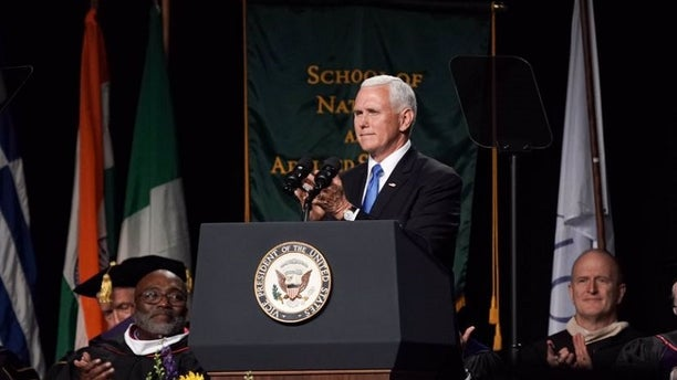 Vice President Mike Pence delivers the commencement address at Taylor University in Upland, Ind., on Saturday.