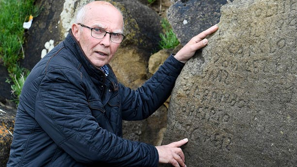 The inscriptions composed of indecipherable words on a rock in the Brittany village of Plougastel-Daoulas. The city launched a national call with a 2,000 euros reward to anyone able to solve the mystery of those inscriptions probably made during the 18th century.