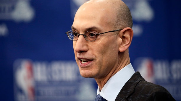 FILE - In this Feb. 16, 2019, file photo, NBA Commissioner Adam Silver speaks during the NBA All-Star festivities in Charlotte, N.C. (AP Photo/Gerry Broome, File)
