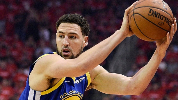 The Warriors appear to have the inside edge to re-sign Thompson.. (AP Photo/Eric Christian Smith)
