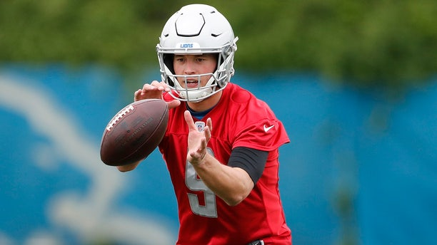 Detroit Lions quarterback Matthew Stafford takes a snap during drills at the team's NFL football practice facility. (AP Photo/Carlos Osorio)