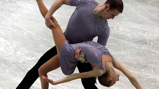 FILE - In this Dec. 8, 2006, file photo, Bridget Namiotka and John Coughlin perform during the ISU Junior Grand Prix of Figure Skating Final in Sofia, Bulgaria. (AP Photo/File)