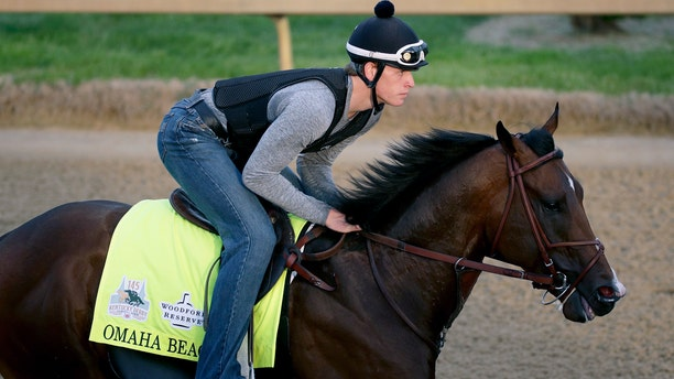 Exercise rider Taylor Cambra works out Omaha Beach at Churchill Downs Wednesday morning. (AP Photo/Charlie Riedel)