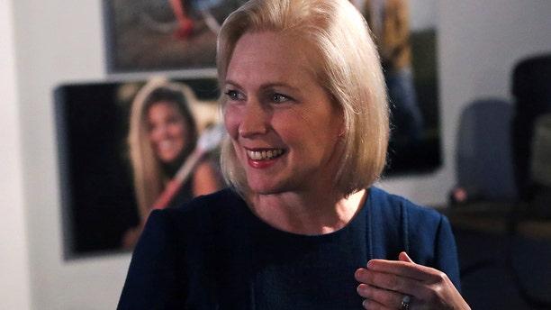 Democratic presidential candidate Sen. Kirsten Gillibrand, D-N.Y., smiles during a campaign stop at a coffee shop in Derry, N.H., Friday, May 10, 2019. (AP Photo/Charles Krupa)
