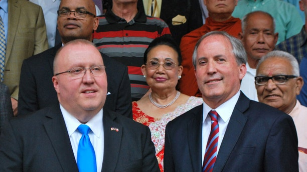 Judge Wayne Mack (left) with Texas Attorney General Ken Paxton and members of the multi-faith chaplain program.