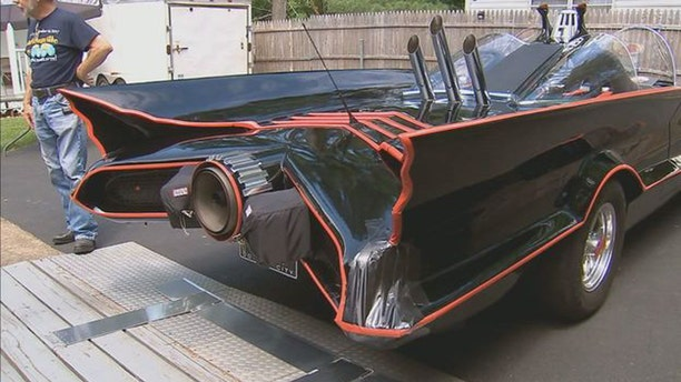 Bill Gibson has tricked out the car with a bat phone, rocket launchers, and projector that shows the bat symbol on the road at night.