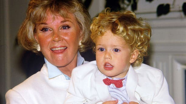 Doris Day poses with her grandson Ryan Melcher, then 4, the son of her only child Terry Melcher at a press conference at the hotel she owns in Carmel, Calif., on July 16, 1985. Day passed away on Monday.