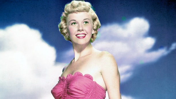 Doris Day is pictured in a pink swimsuit in 1955. The legendary actress and singer passed away on May 13, 2019 at 97 years old.