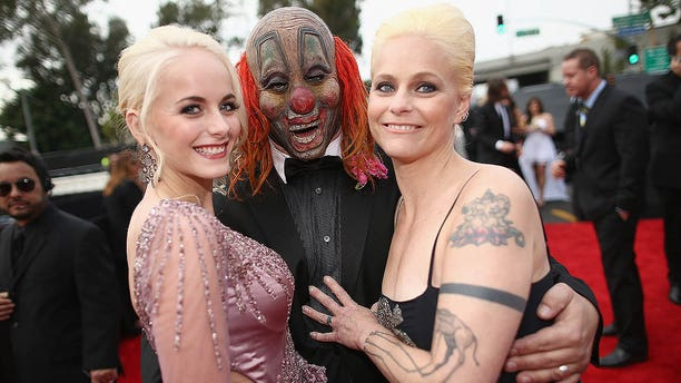 """Musician Shawn """"Clown"""" Crahan attends the Grammys with daughter Gabrielle and wife Chantel Crahan on Jan. 26, 2014, in Los Angeles. Gabrielle passed away this week at 22."""