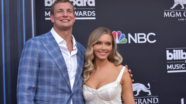 Gronkowski and Camille Kostek arrive at the Billboard Music Awards. (Photo by Richard Shotwell/Invision/AP)
