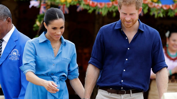 Britain's Prince Harry and Meghan, Duchess of Sussex smile during a visit to Tupou College in Tonga, Friday, Oct. 26, 2018. Prince Harry and his wife Meghan are on day eleven of their 16-day tour of Australia and the South Pacific.