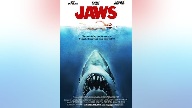 The famous movie poster for 'Jaws' is seen above.