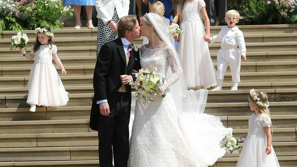 Newlyweds Thomas Kingston and Lady Gabriella Windsor share a kiss on the steps of the chapel after their wedding at St George's Chapel, Windsor Castle, near London, England, Saturday, May 18, 2019. (Chris Jackson/Pool via AP)